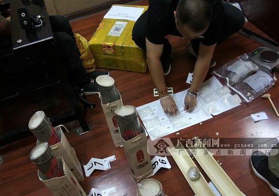 竹筒酒里藏冰毒 贺州警方打掉一跨国贩毒团伙(图)